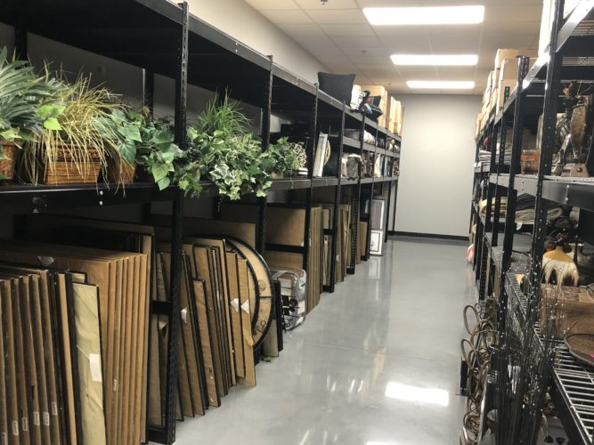 Inside the Corporate Connection warehouse with view of Decor items