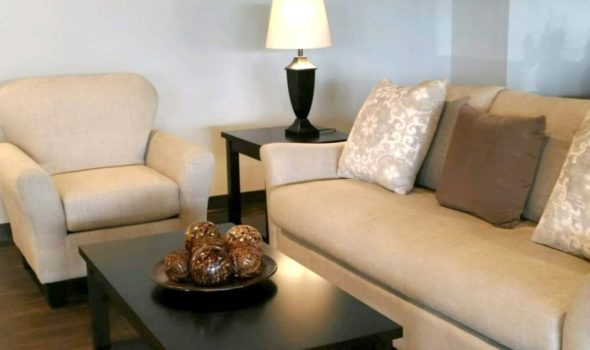 living room setting with, chair, couch, end table, and coffee table