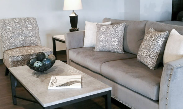 living room setting with couch, end table, and coffee table