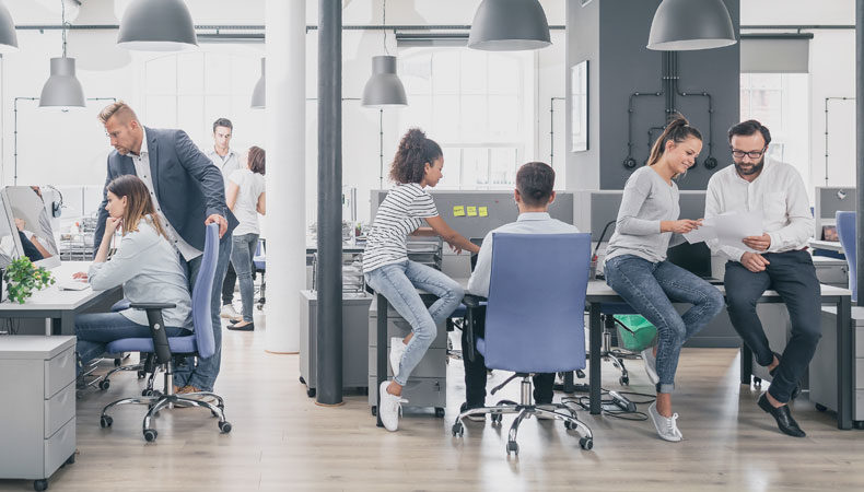 office setting with employees working together