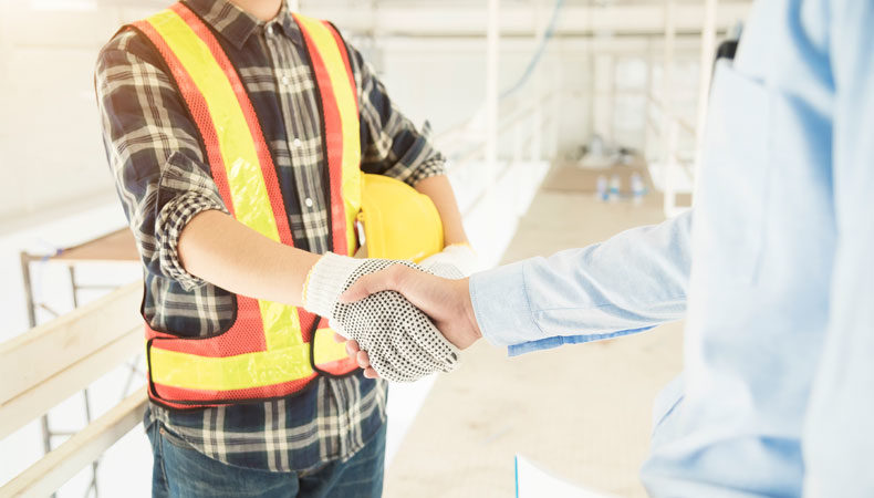 Contractor shaking hands with a supervisor