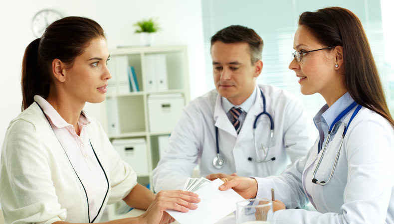 Three Healthcare Professionals working together
